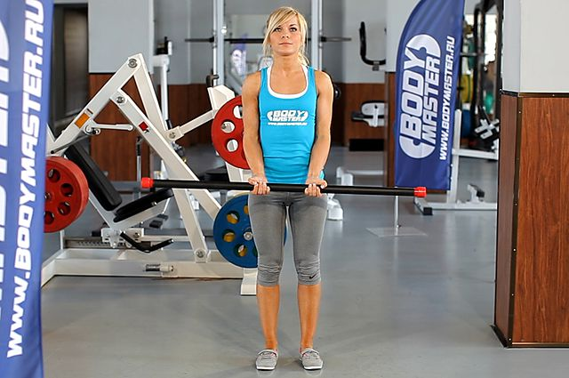 Photo of Close-Grip Standing Barbell Curl exercise