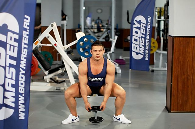 Photo of Plie Dumbbell Squat  exercise