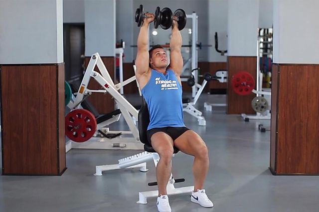 Photo of Arnold Dumbbell Press exercise
