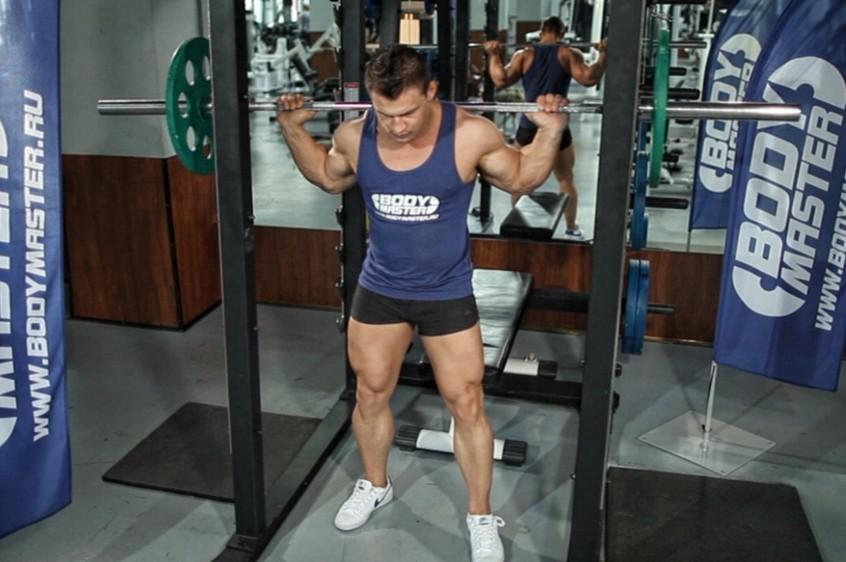 Упражнение Приседания со штангой, используя скамью