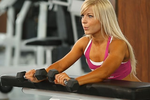 Photo of Palms-Down Dumbbell Wrist Curl Over A Bench exercise