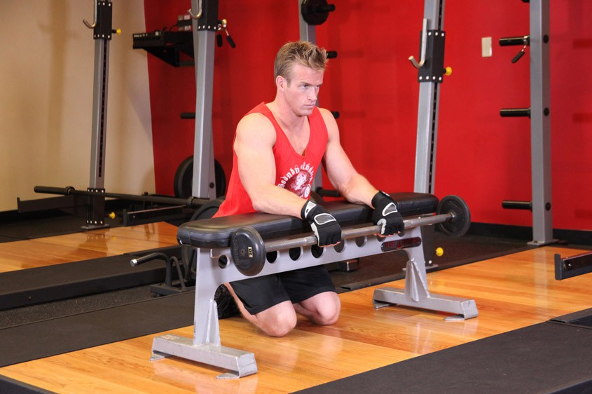 Exercise Palms-Down Wrist Curl Over A Bench