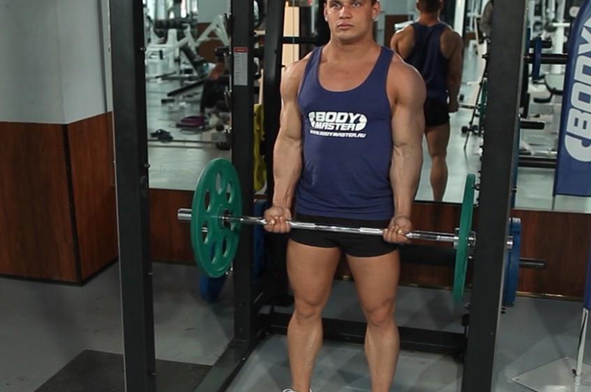 Упражнение Сгибание рук на бицепс с EZ-штангой стоя