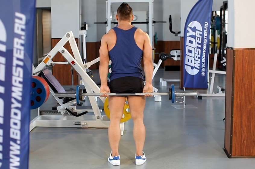 Exercise Standing Palms-Up Barbell Behind The Back Wrist Curl