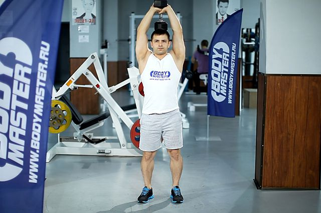 Photo of Standing Dumbbell Triceps Extension exercise