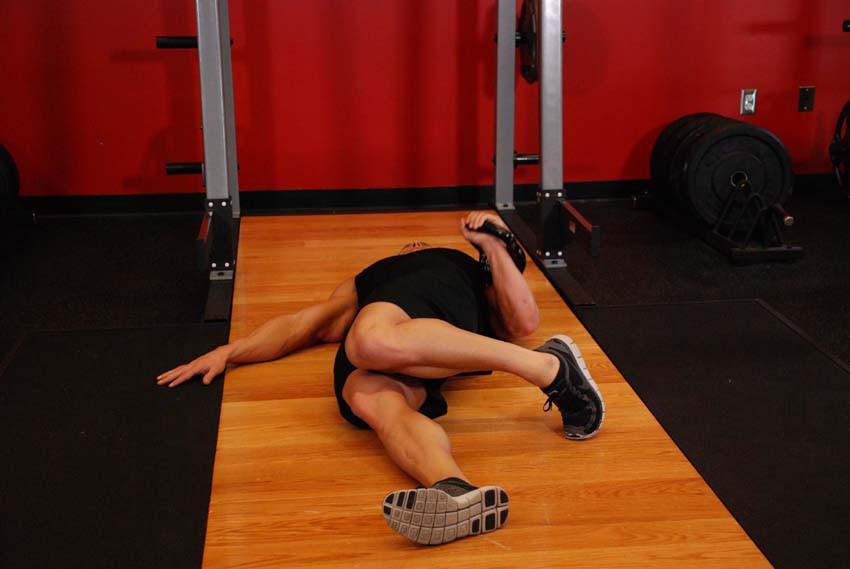 Упражнение Жим гири лежа одной рукой