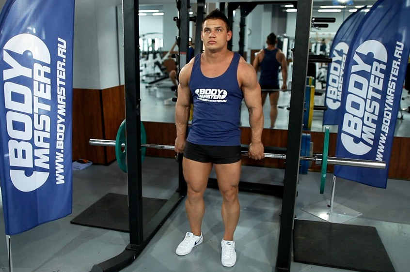 Exercise Barbell Shrug Behind The Back