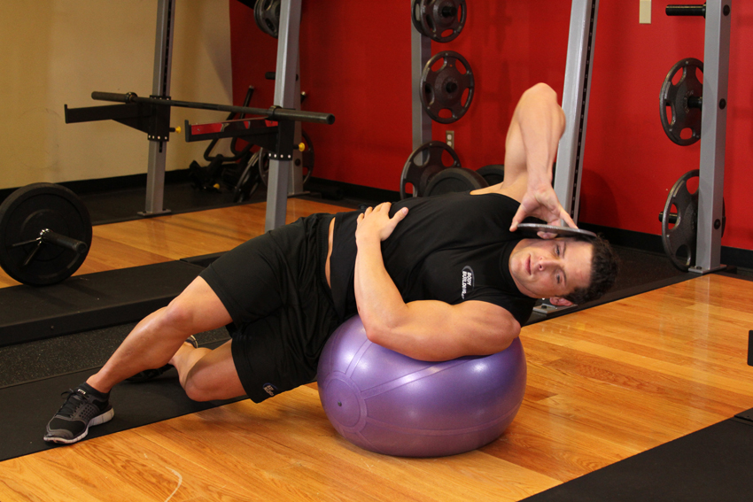 Exercise Weighted Ball Side Bend
