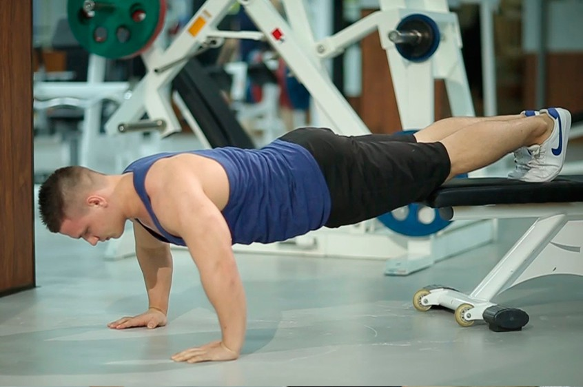 Exercise Push-Ups With Feet Elevated