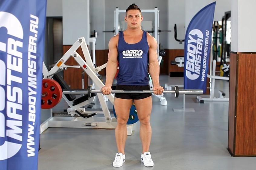 Упражнение Подъем штанги на бицепс широким хватом