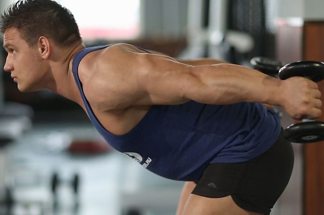 Photo of Standing Bent-Over Two-Arm Dumbbell Triceps Extension exercise