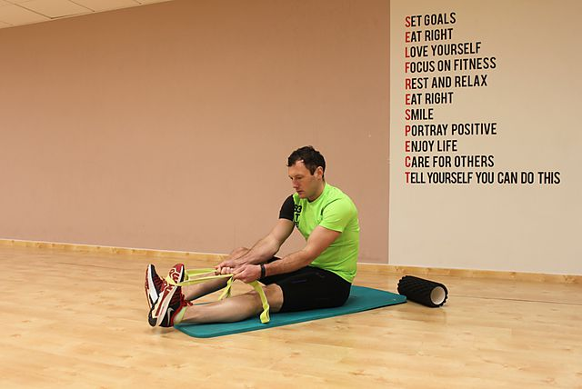 Photo of Seated Hamstring and Calf Stretch exercise