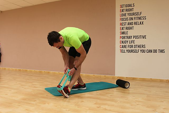 Photo of Standing Hamstring and Calf Stretch exercise