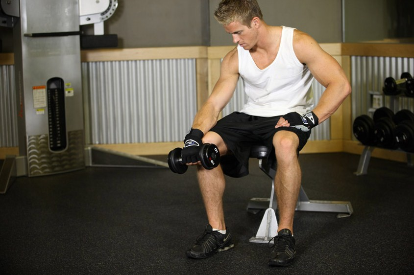 Exercise Seated One-Arm Dumbbell Palms-Down Wrist Curl