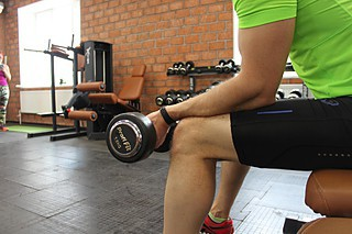Seated One-Arm Dumbbell Palms-Up Wrist Curl