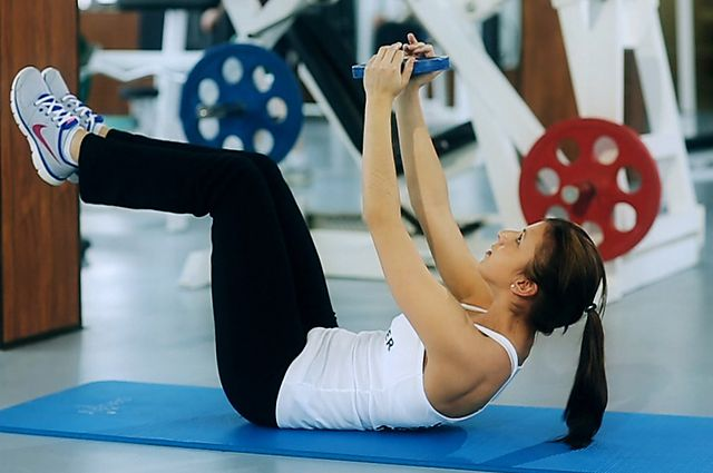 Photo of Weighted Crunches  exercise