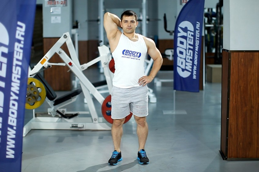 Exercise Standing One-Arm Dumbbell Triceps Extension