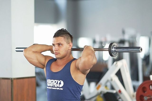 Photo of Standing Overhead Barbell Triceps Extension exercise