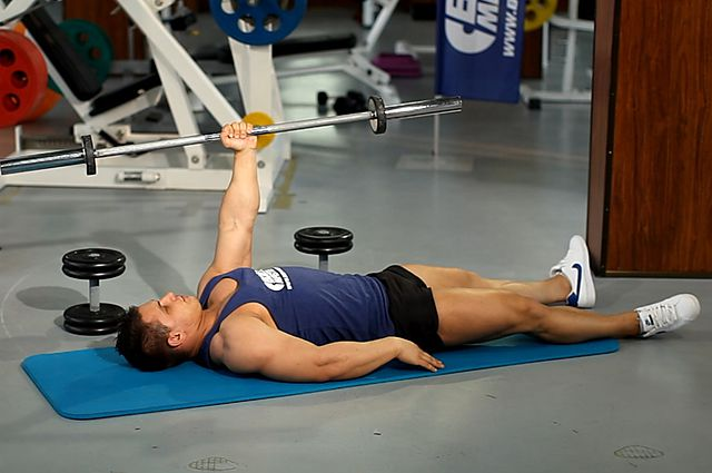 Photo of One Arm Floor Press  exercise