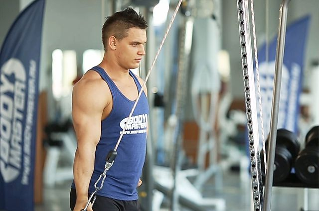 Photo of Cable One Arm Tricep Extension exercise